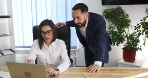 Business couple working together on project at modern startup office.  stock video
