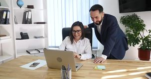 Business couple working together on project at modern startup office stock footage