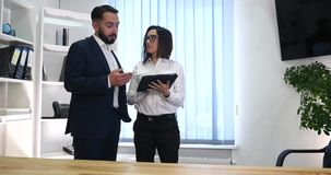 Business couple working together on project at modern startup office.  stock video footage