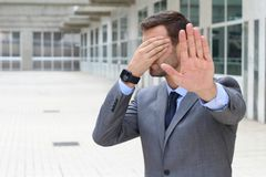Business covering his eyes to avoid reality royalty free stock image