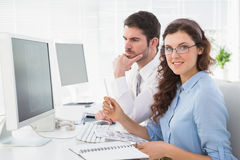 Business coworkers brainstorming together at desk Stock Image