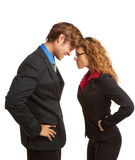 Business Coworkers Butting Heads. Business rivalry competition between business men and women butting heads isolated on white background Stock Photos