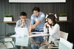 Business coworkers discussing in meeting room in office stock photo