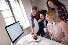 Business coworkers discussing new ideas and brainstorming in office. Business coworkers discussing new ideas and brainstorming in a modern office Royalty Free Stock Photography
