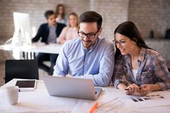 Business coworkers discussing new ideas and brainstorming in office. Business coworkers discussing new ideas and brainstorming in a modern office Royalty Free Stock Photos