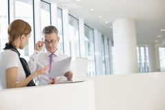 Business coworkers discussing work in office Stock Images