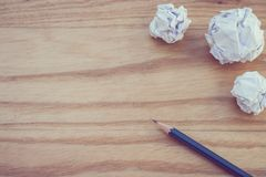 Top view of three pencil with white crumpled paper ball put on wooden floor. Business Creative and Idea Concept Top view of three pencil with white crumpled Royalty Free Stock Images