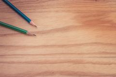 Business creative and idea concept top view of two pencil put on wooden floor. Selective focus Stock Photo