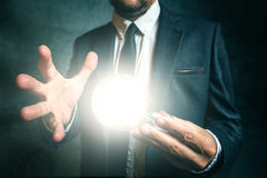 Business creativity concept with businessman holding light in ha Stock Photography