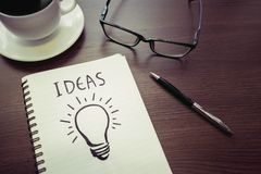 Business creativity concepts ideas.light bulb drawing on notepad Royalty Free Stock Photo