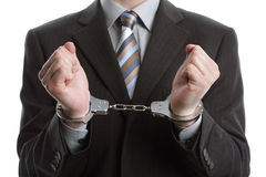 Business crime. Corporate crime concept, businessman wearing handcuffs Royalty Free Stock Image