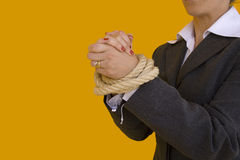 Business crime. A business woman with her hands tied for a corporate crime Stock Photo