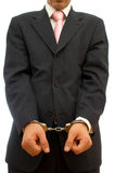 Business crime. Businessman with handcuffs for business crime concept Royalty Free Stock Photography