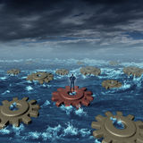 Business Crisis Management. Concept as a businessman on a machine cog floating with a group of other detached gears on a stormy sea as a symbol of industry Stock Photography