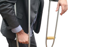 Business and crutches Royalty Free Stock Image