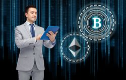 Businessman with tablet pc and cryptocurrency Royalty Free Stock Images
