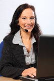 Business of customer service over the telephone. Beautiful young woman providing customer service with a smile, sitting to her computer speaking on a telephone Stock Photos