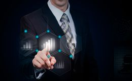 Business, cyberspace and future technology concept - close up of businessman in suit working with virtual charts over dark backg. Round Royalty Free Stock Photo