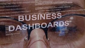 Business dashboards text on background of female developer stock footage
