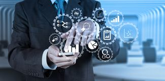 Businessman hand use smart phone computer with email icon as con. Business data analytics management with connected gear cogs with KPI financial charts and graph Royalty Free Stock Photo