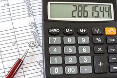 Business Data Analyzing. Macro Image Of Calculator And Pen On Business Document Royalty Free Stock Photos