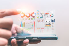 Business data infomation bring out from smartphone Royalty Free Stock Photos