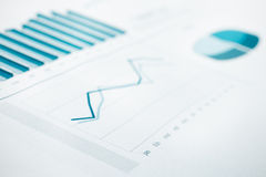 Business data report and chart print. Selective Focus. Blue toned. Business data report and chart close up. Montly stats. Ink color print paper. Selective Focus Stock Images