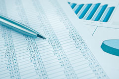 Business data report print and pen. Blue toned. Stock Photo