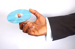 Business Data Secured. This is an image of a black business man holding a data cd royalty free stock photos