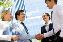Business deal. Photo of successful partners handshaking after striking deal at meeting royalty free stock photo