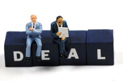 Business deal. Two businessmen making a deal Royalty Free Stock Photos