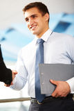 Business deal. Photo of confident businessman handshaking with partner after signing contract Stock Photos