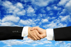 Business deal. Two businessmen shaking hands on a successful deal Royalty Free Stock Photo