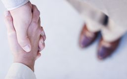Business deal. Business man and woman shake hands over the new deal Stock Images