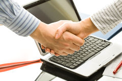 Business deal. Successful handshake to seal a business deal in an office Stock Images