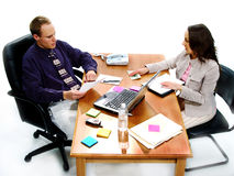Business Deal 5. Businessman and woman negoiate a cash deal at a desk Royalty Free Stock Image