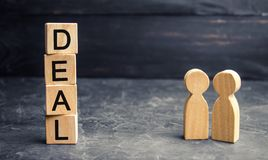 Business deal concept. Two people discuss the terms of the transaction. Financial Agreement. Manage and win in teamwork. royalty free stock images