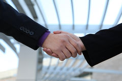 Business deal handshake. A man and woman handshake to conclude a successful business deal Royalty Free Stock Photography