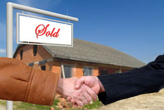 Business deal, handshake on house sale Stock Photography
