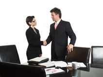 Business deal - isolated. Young business people are shaking hands after a business deal. Isolated version Stock Image