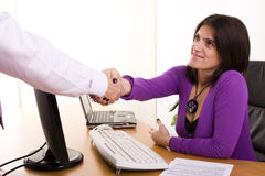 Business deal at the office. Businesswoman sealing a deal at her office (selective focus Royalty Free Stock Photos