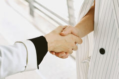Business deal and office concept, Businesswomen shaking hands. Royalty Free Stock Photos