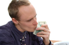 Business Deal Sealed 4. Businessman kisses $100 bills as he celebrates a paid business deal Stock Photography