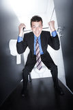 Business deal on toilet Royalty Free Stock Images