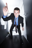 Business deal on toilet Stock Photography