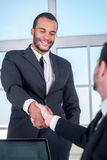 Business dealings. African businessman shake hands with another Royalty Free Stock Image