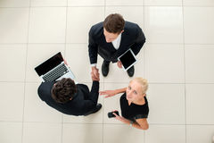 Business dealings. Top view of three business people in formal w Royalty Free Stock Images
