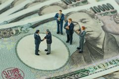 Business deals or agreement concept as miniature figure business Royalty Free Stock Photos