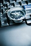 Business decision. Computer keyboard and retro compass, business decision Royalty Free Stock Photo