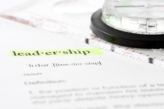 Business Definition. Leadership definition with a compass imlpying leadership and direction stock photography